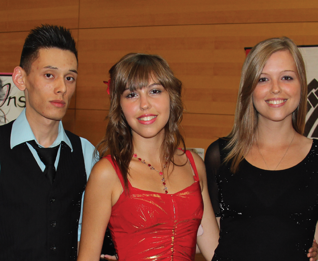 Emilia Nowicki, in red, takes a break with friends while performing at the Mssissauga Arts Council media event.