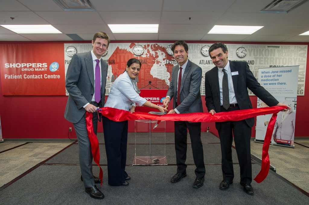 Galen G. Weston, Executive Chairman and President, Loblaw Companies Limited, Amrit Mangat, MPP Mississauga--Brampton South, Dr. Eric Hoskins, Minister of Health and Long-Term Care, and Mike Motz, President, Shoppers Drug Mart, cut the ribbon for the grand opening of the first-of-its-kind Patient Contact Centre in Canada. The Shoppers Drug Mart Patient Contact Centre is creating 140 new highly-skilled jobs and helping to ensure patients are taking their medications as prescribed.